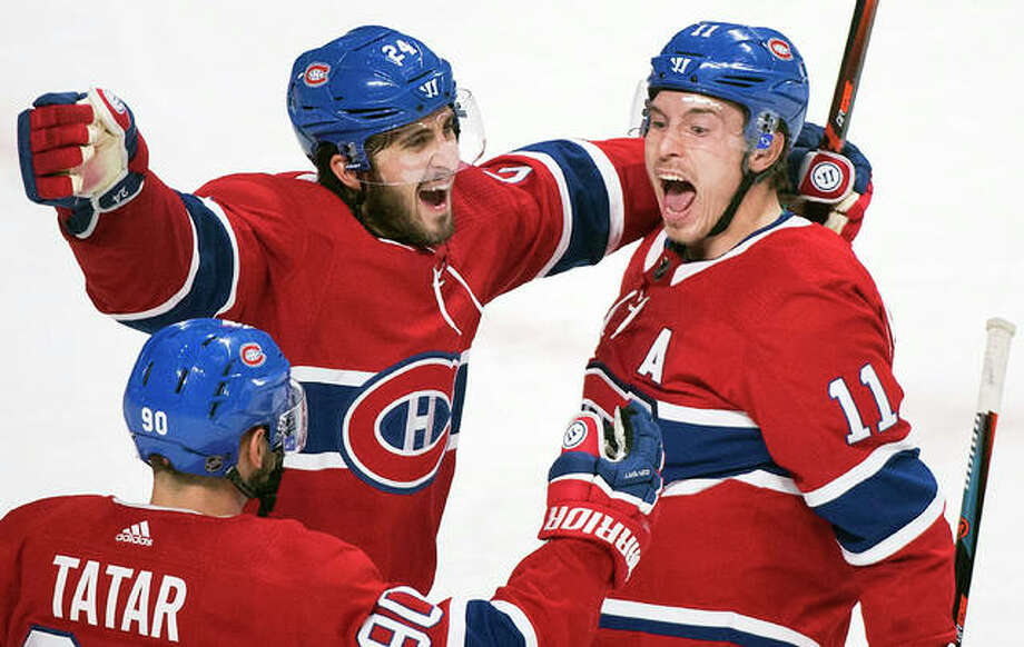 Montreal's Brendan Gallagher (11) celebrates with teammates Phillip Danault (24) and Tomas Tatar after scoring against the Blues Wenesday night in Montreal. Photo: AP Photo
