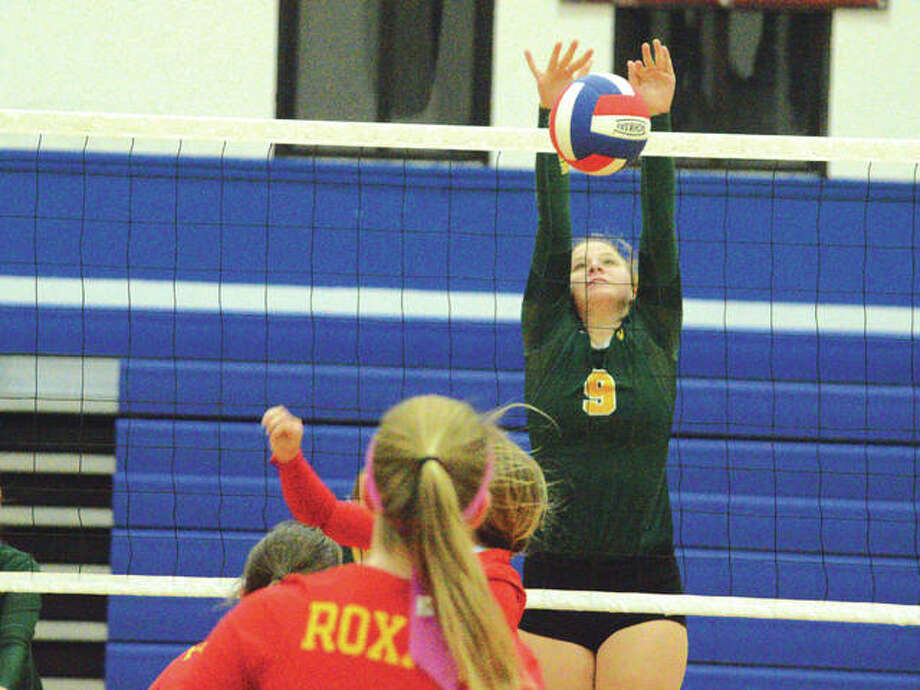 Metro-East Lutheran sophomore Caitlin Reynolds goes up for a block in Wednesday's match at Roxana. Photo: Scott Marion/Intelligencer