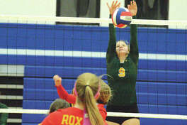 Metro-East Lutheran sophomore Caitlin Reynolds goes up for a block in Wednesday's match at Roxana.