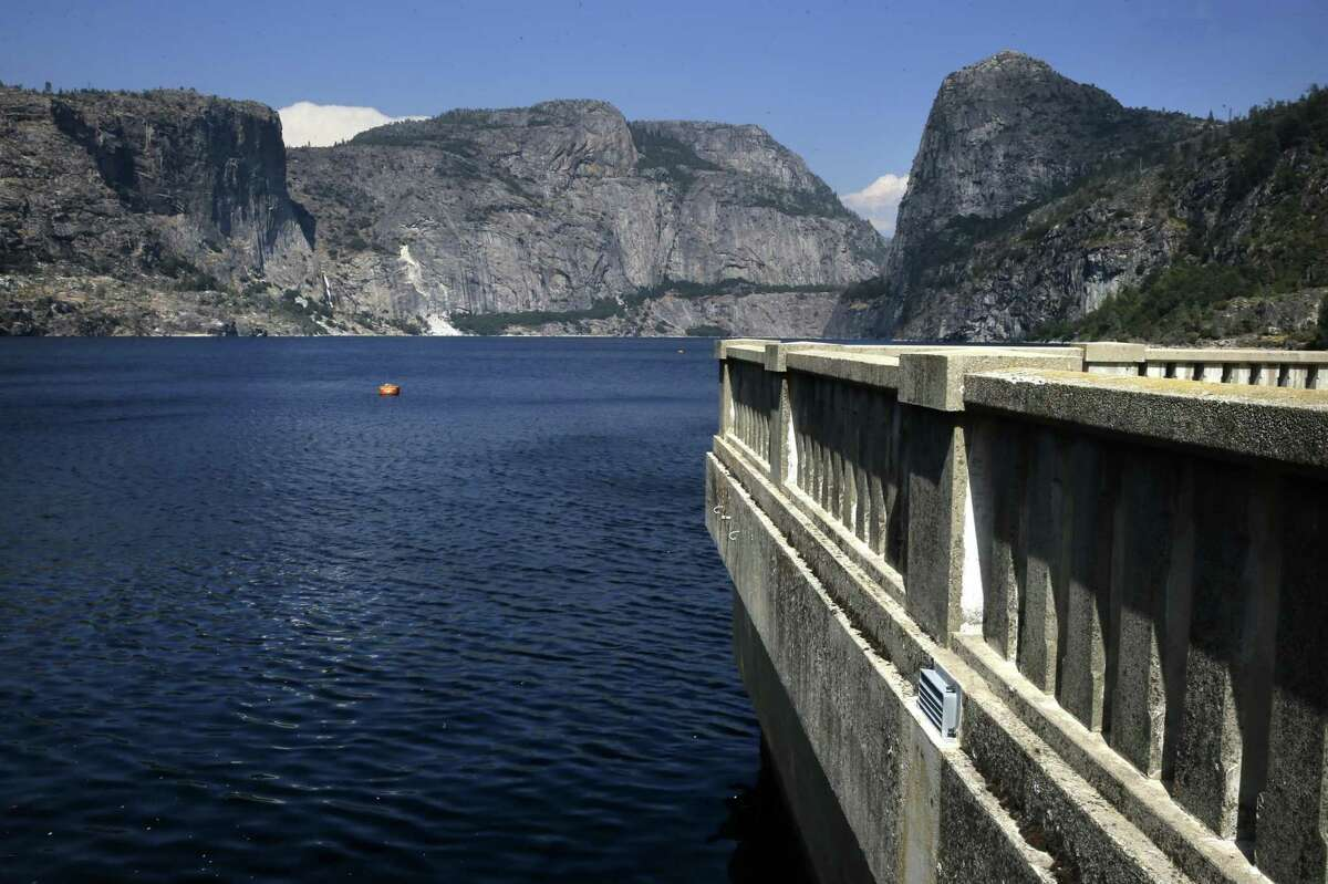 FILE-- Looking out over Hetch Hetchy reservoir from the O'Shaughnessy Dam in Yosemite National Park, Calif. on Thurs. July 28, 2016. The city of San Francisco is not standing down in California's latest water war, joining a lawsuit Thursday against the state for ordering more of the Sierra's cool, crisp flows to go to fish instead of people.