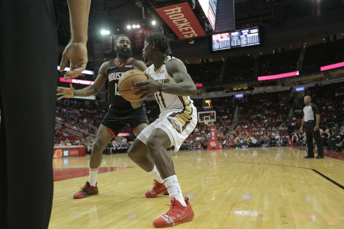 Houston Rockets guard James Harden (13) holds his 2017-2018 NBA MVP trophy before the Rockets season home opener against the New Orleans Pelicans at the Toyota Center on Wednesday, Oct. 17, 2018 in Houston. New Orleans Pelicans won the game 131-112.