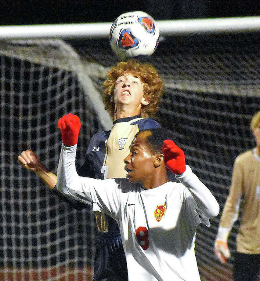 Father McGivney's DJ Villhard, back, goes up for a header during the first half against Murphysboro on Wednesday in Belleville. Photo: Matt Kamp | For The Telegraph