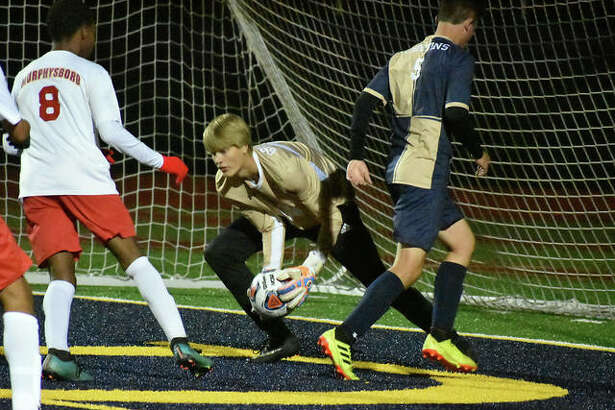 Father McGivney keeper Nate Dammerich, center, makes a save in the first half against Murphysboro on Wednesday in Belleville.