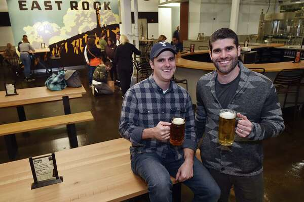 Trumbull resident Shaun Wilson and his brother Tim Wilson, of Orange are co-owners of East Rock Brewing Company are surrounded by family and friends Wednesday, October 17, 2018 at East Rock Center. The brewery located at 285 Nicoll Street in New Haven opens today at 3 p.m.