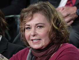 """FILE - In this Monday, Jan. 8, 2018, file photo, Roseanne Barr participates in the """"Roseanne"""" panel during the Disney/ABC Television Critics Association Winter Press Tour in Pasadena, Calif. Barr will appear on television for the first time since she was fired from ABC and her namesake show was canceled. Barr will be a guest on the Fox News show """"Hannity"""" on Thursday, July 26, 2018, at 9 p.m. EDT. (Photo by Richard Shotwell/Invision/AP, File)"""