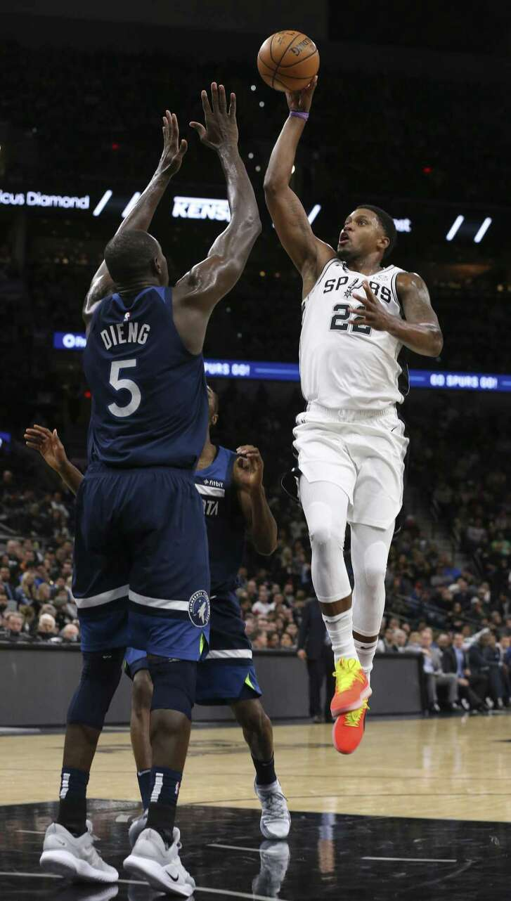 San Antonio Spurs' Rudy Gay shoots over Minnesota Timberwolves' Gorgui Dieng during the first half at the AT&T Center, Wednesday, Oct. 17, 2018.