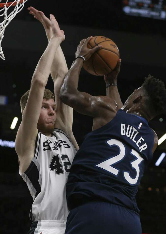 San Antonio Spurs' Davis Bertans defends against Minnesota Timberwolves' Jimmy Butler during the second half at the AT&T Center, Wednesday, Oct. 17, 2018. The Spurs won the season opener, 112-108. Photo: JERRY LARA / San Antonio Express-News / © 2018 San Antonio Express-News