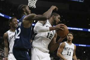 San Antonio Spurs' LaMarcus Aldridge gets the rebound against Minnesota Timberwolves' Andrew Wiggins to end the game at the AT&T Center, Wednesday, Oct. 17, 2018. The Spurs won the season opener, 112-108.