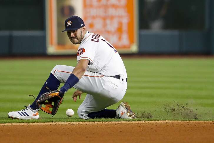 Houston Astros Carlos Correa (1) fields a ground ball from Boston Red Sox J.D. Martinez (28) during the fifth inning of Game 4 of the American League Championship Series at Minute Maid Park on Wednesday, Oct. 17, 2018, in Houston.