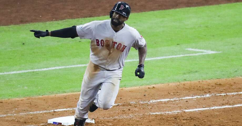 Boston Red Sox Jackie Bradley Jr. (19) rounds first after hitting a two run home run to give Boston a 6-5 lead during the sixth inning of Game 4 of the American League Championship Series at Minute Maid Park on Wednesday, Oct. 17, 2018, in Houston. Photo: Michael Ciaglo/Staff Photographer