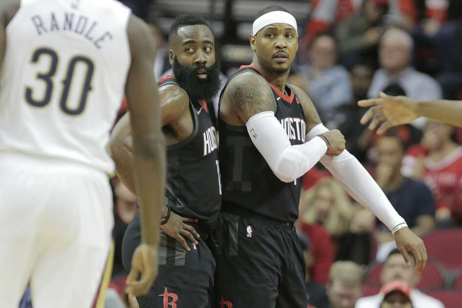 Houston Rockets guard James Harden (13) and Houston Rockets forward Carmelo Anthony (7) prepare to play defense against the New Orleans Pelicans at the Toyota Center on Wednesday, Oct. 17, 2018 in Houston. New Orleans Pelicans won the game 131-112.