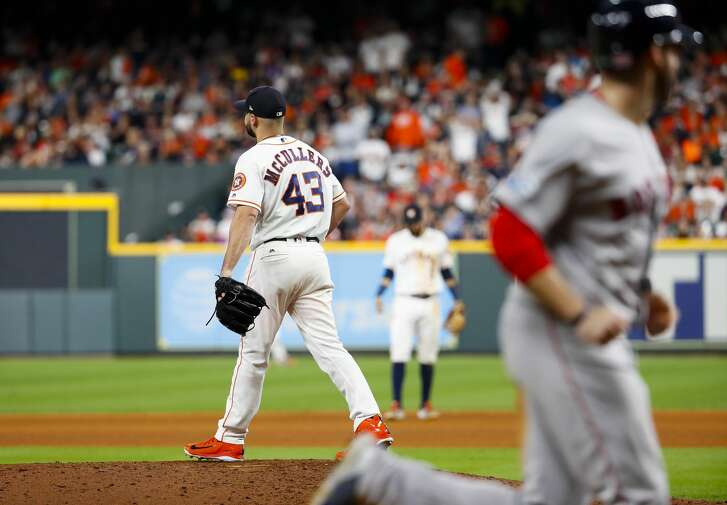Houston Astros relief pitcher Lance McCullers Jr. (43) reacts after walking Boston Red Sox Brock Holt (12) allowing Boston Red Sox J.D. Martinez (28) to score during the seventh inning of Game 4 of the American League Championship Series at Minute Maid Park on Wednesday, Oct. 17, 2018, in Houston.