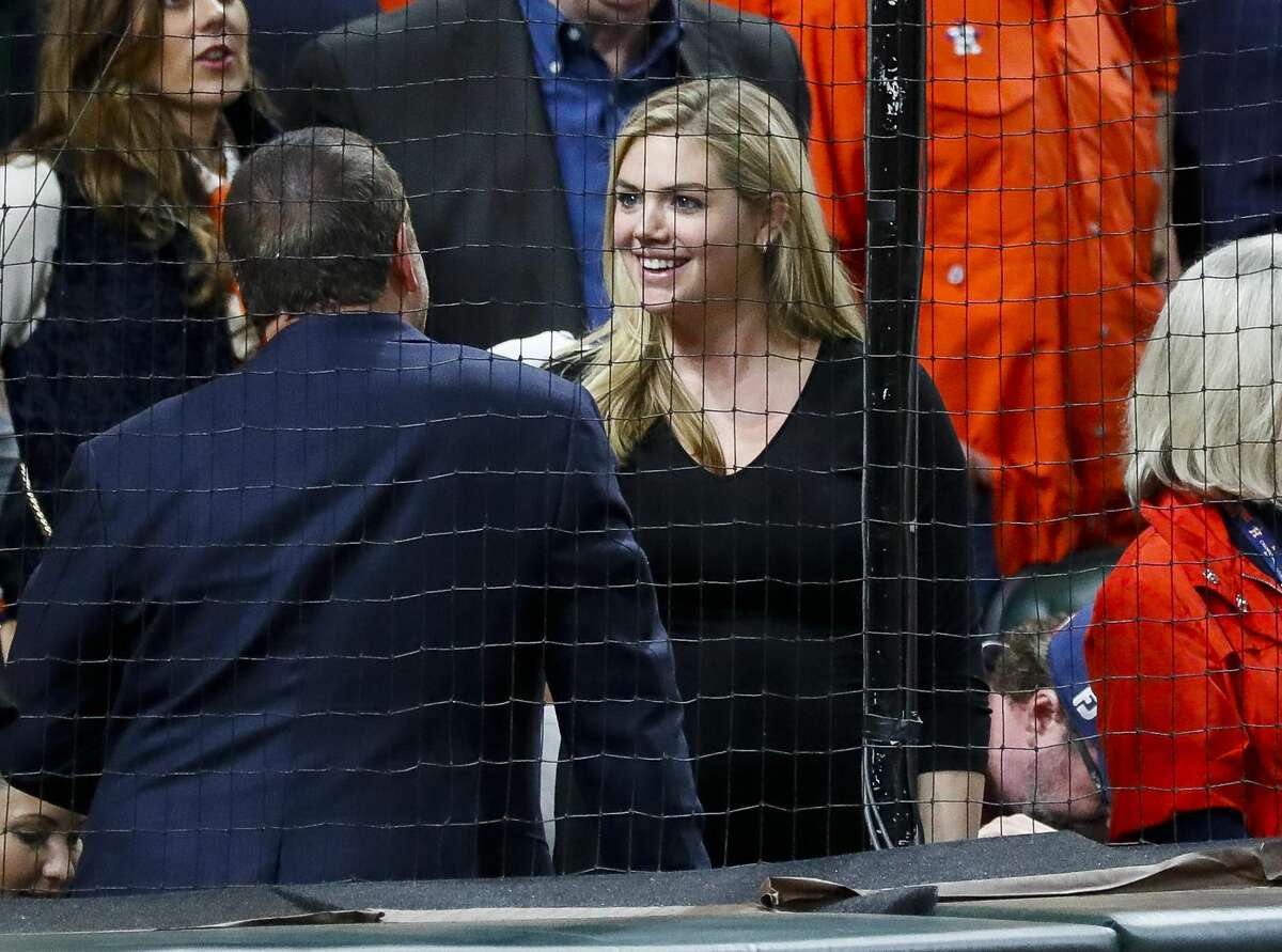 Kate Upton talks from her seat behind home plate during the seventh inning stretch of Game 4 of the American League Championship Series at Minute Maid Park on Wednesday, Oct. 17, 2018, in Houston.