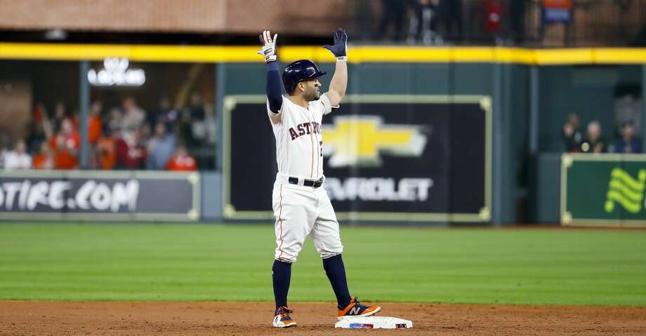Houston Astros designated hitter Jose Altuve (27) reacts as he is called out because of fan interference from a long ball he drove over the wall in right field that Boston Red Sox Mookie Betts (50) tried to catch during the first inning of Game 4 of the American League Championship Series at Minute Maid Park on Wednesday, Oct. 17, 2018, in Houston. The play was reviewed and Altuve was called out. Photo: Brett Coomer/Staff Photographer