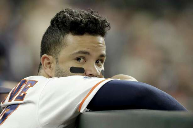 Houston Astros second baseman Jose Altuve watches during the ninth inning in Game 4 of a baseball American League Championship Series against the Boston Red Sox on Wednesday in Houston.