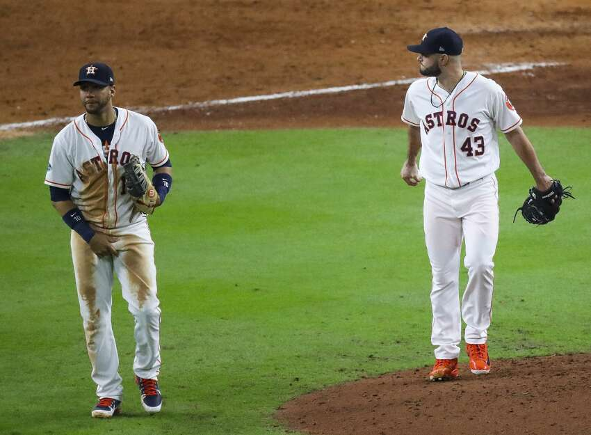 Houston Astros Yuli Gurriel (10) and relief pitcher Lance McCullers Jr. (43) reacts after McCullers Jr. allowed an RBI single by Boston Red Sox J.D. Martinez (28) during the eighth inning of Game 4 of the American League Championship Series at Minute Maid Park on Wednesday, Oct. 17, 2018, in Houston.