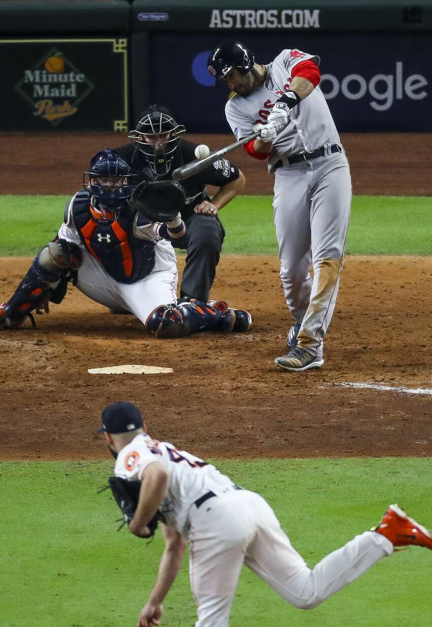 Boston Red Sox J.D. Martinez (28) hits an RBI single during the eighth inning of Game 4 of the American League Championship Series at Minute Maid Park on Wednesday, Oct. 17, 2018, in Houston.