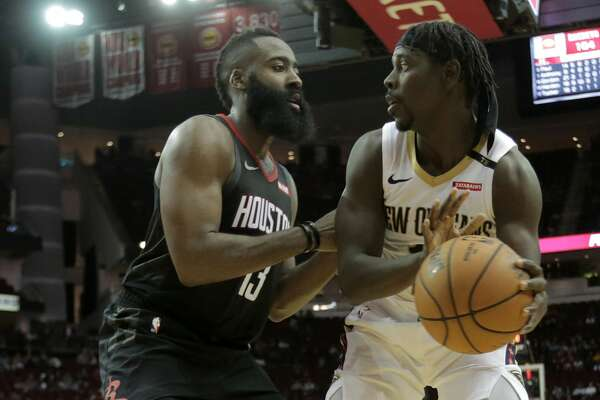 Houston Rockets guard James Harden (13) plays defense against New Orleans Pelicans guard Jrue Holiday (11) at the Toyota Center on Wednesday, Oct. 17, 2018 in Houston. New Orleans Pelicans won the game 131-112.