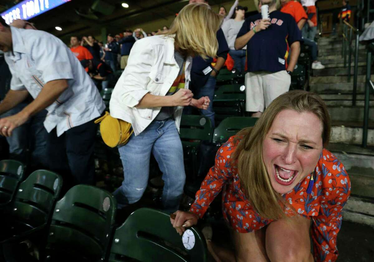 Houston Astros fans react to Houston Astros third baseman Alex Bregman's out ending the bottom ninth inning of Game 4 of the American League Championship Series at Minute Maid Parkon Thursday, Oct. 18, 2018, in Houston. The Houston Astros lost to the Boston Red Sox 8-6.