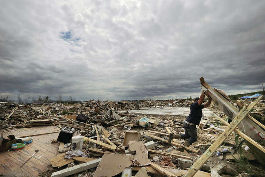 Dustin Shaw lifts debris as he searches through what is left of his sister's house at Parkwood Meadows neighborhood after a tornado in Vilonia, Arkansas, in 2014. A new study finds that tornado activity is generally shifting eastward to areas just east of the Mississippi River that are more vulnerable such as Mississippi, Arkansas and Tennessee. And it's going down in Oklahoma, Kansas and Texas. Photo: Danny Johnston | AP