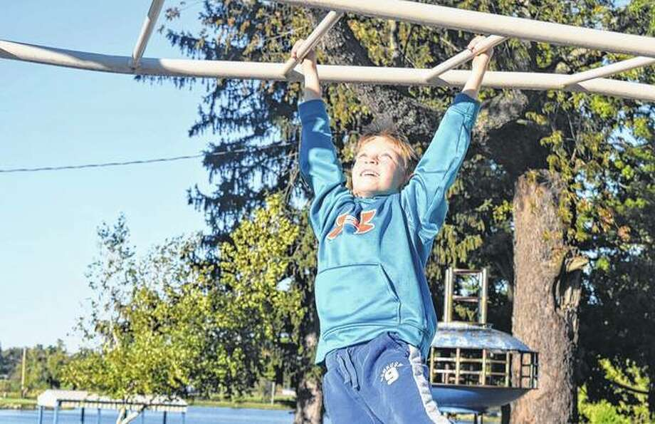 Lincoln Rowe, 7, the son of Richard and Misty Rowe of South Jacksonville, plays on the monkey bars Wednesday at Nichols Park. Photo: Samantha McDaniel-Ogletree | Journal-Courier