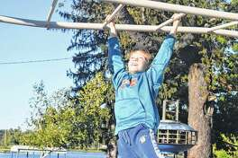 Lincoln Rowe, 7, the son of Richard and Misty Rowe of South Jacksonville, plays on the monkey bars Wednesday at Nichols Park.