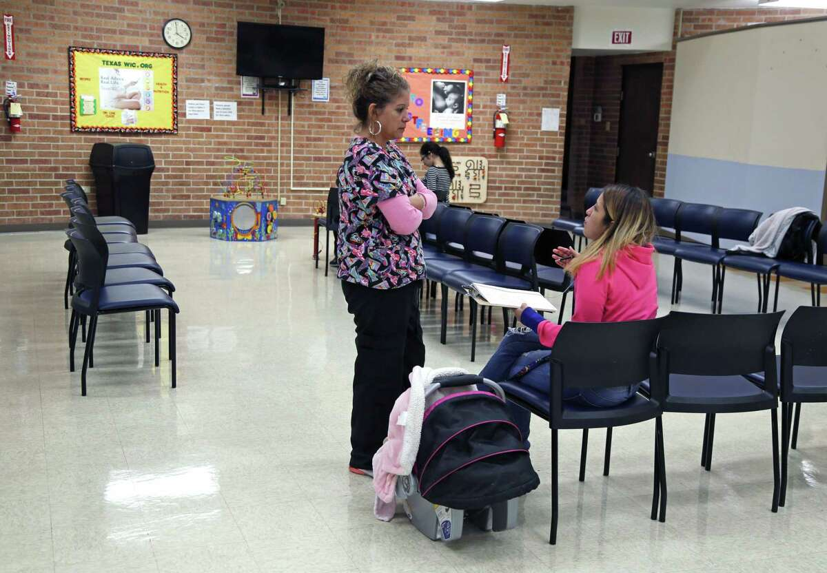 Jeannie Garcia talks with Debbie Garza, who works for the program known as WIC, or Special Supplemental Nutrition Program for Women, Infant and Children. Garcia was at WIC clinic on Buena Vista on Oct. 16, 2018.