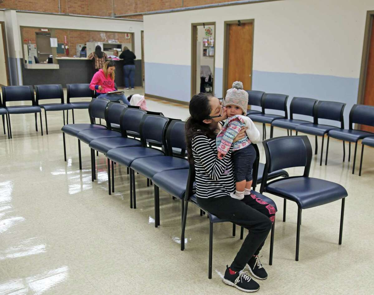 Maria Esclante with her child Hazel Beck,11 months, waits to be seen at the WIC clinic on Buena Vista on Oct. 16, 2018.