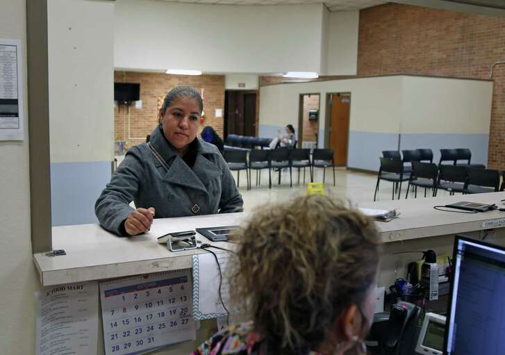 Lily Gutierrez, originally from Piedra Negras, Mexico, enrolls in a class at a WIC clinic on Buena Vista on Oct. 16, 2018.