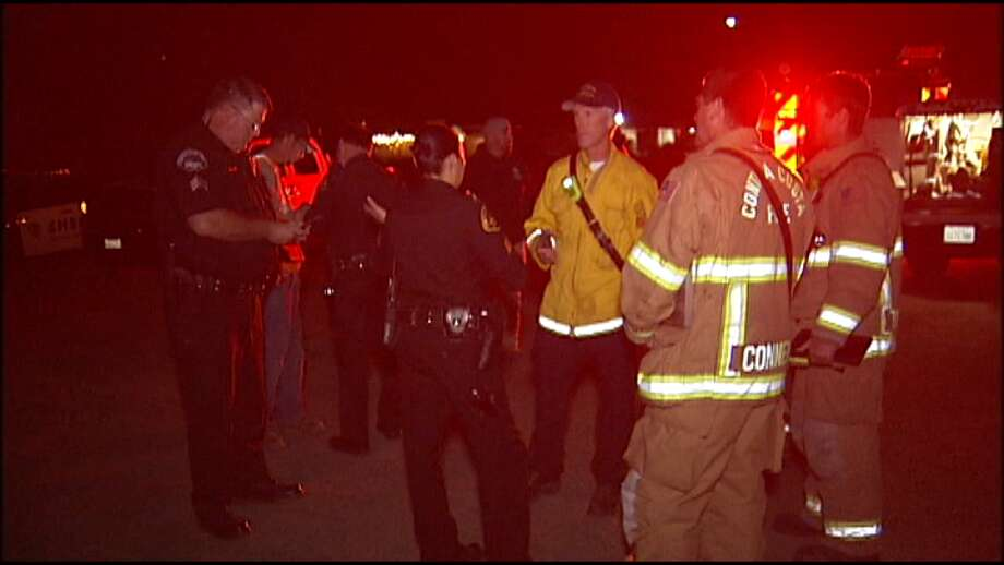 First responders coordinate an evacuation after a power outage at Bay Point has caused a grass burn. A grass fire threatens an underground Chevron gas pipeline Wednesday Night in Bay Point forced the evacuation of 4,000 people, officials said. Photo: KTVU