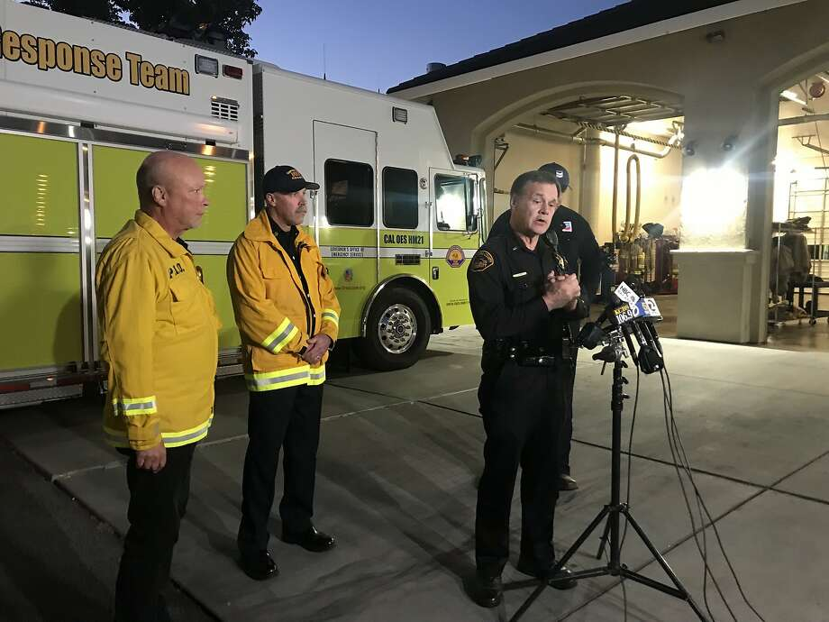 Officials with the Contra Costa County Fire Protection District, Sheriff's Office and Chevron update the public on a fire at the oil company's facility in Bay Point. Photo: Sarah Ravani /