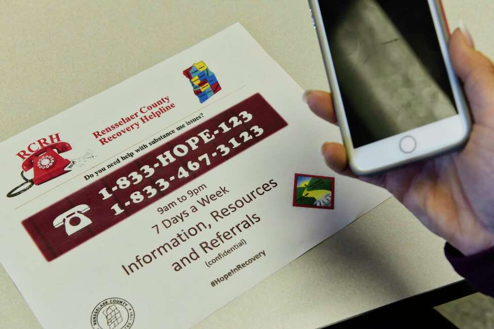 A view of a flier for the new Rensselaer County Recovery Helpline, seen at the Rensselaer County Office Building on Thursday, Oct. 18, 2018, in Troy, N.Y. Residents can call the helpline at 1-833-HOPE-123 to receive information, resources or referrals for themselves or anyone needing help with substance abuse and recovery. (Paul Buckowski/Times Union)