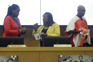 Wanda Adams, left, Grenita Lathan, center, and Jolanda Jones, right, arrive to the Houston ISD school board meeting Thursday, Oct. 18, 2018, in Houston.