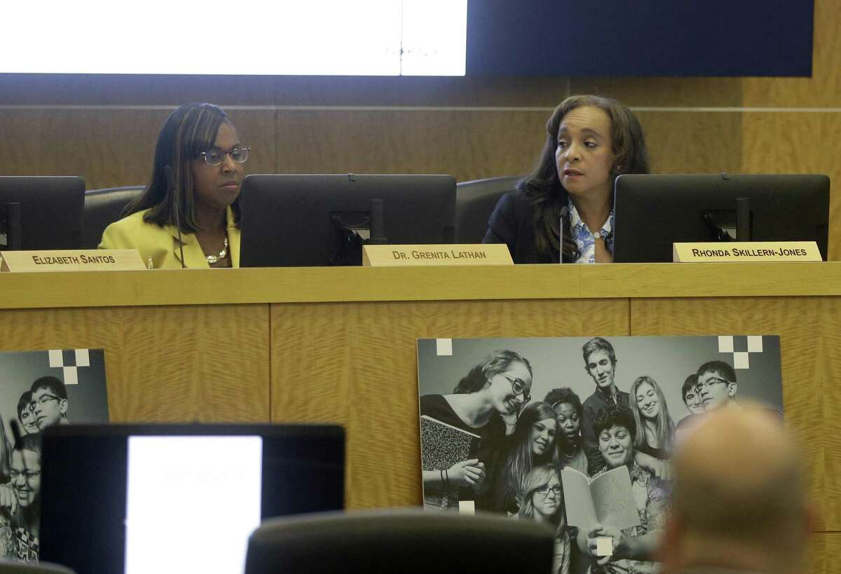 Grenita Lathan, left, and Rhonda Skillern-Jones, board president, right, are shown during the Houston ISD school board meeting Thursday, Oct. 18, 2018, in Houston. Lathan was reinstated as HISD interim superintendent.