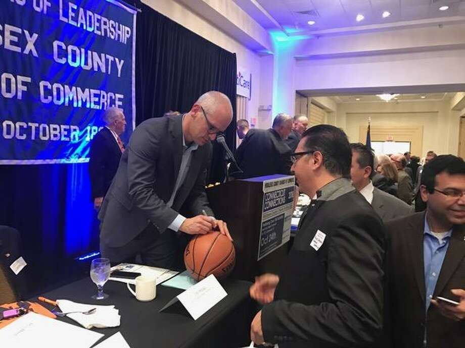 UConn coach Dan Hurley autographs a basketball at Thursday's Middlesex County Chamber of Commerce breakfast. Photo: David Borges / New Haven Register