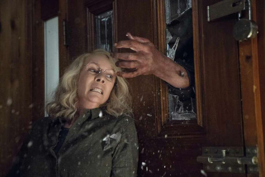"""This image released by Universal Pictures shows Jamie Lee Curtis in a scene from """"Halloween."""" Photo: Ryan Green, HONS / Associated Press / © Universal Pictures"""