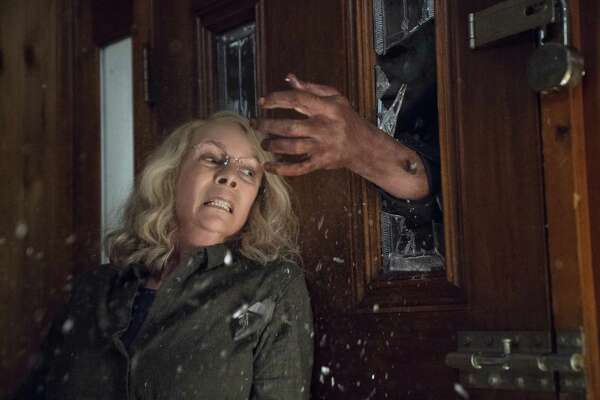 """This image released by Universal Pictures shows Jamie Lee Curtis in a scene from """"Halloween."""""""