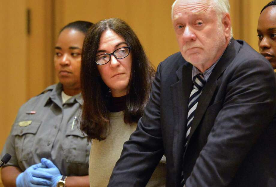 Stacy Lore stands with her Public Defender Howard Ehring in Stamford Superior Court on Monday July 9, 2018 in Stamford Conn. Lore fraudulently passed herself off as an autism specialist and was in court for failing to pay enough restitution to her victims Photo: Alex Von Kleydorff / Hearst Connecticut Media / Norwalk Hour