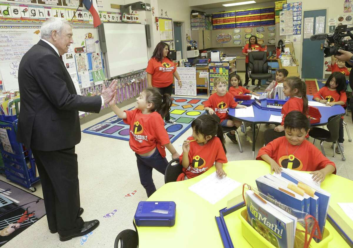 Dan Rather gets a high five from Love Elementary School kindergartener Ava Mendez, 5, as he visits the classroom of Brenda Munoz before being the guest of honor at a school program Friday, Oct. 12, 2018, in Houston. He was a student at the school in the late 1930s.