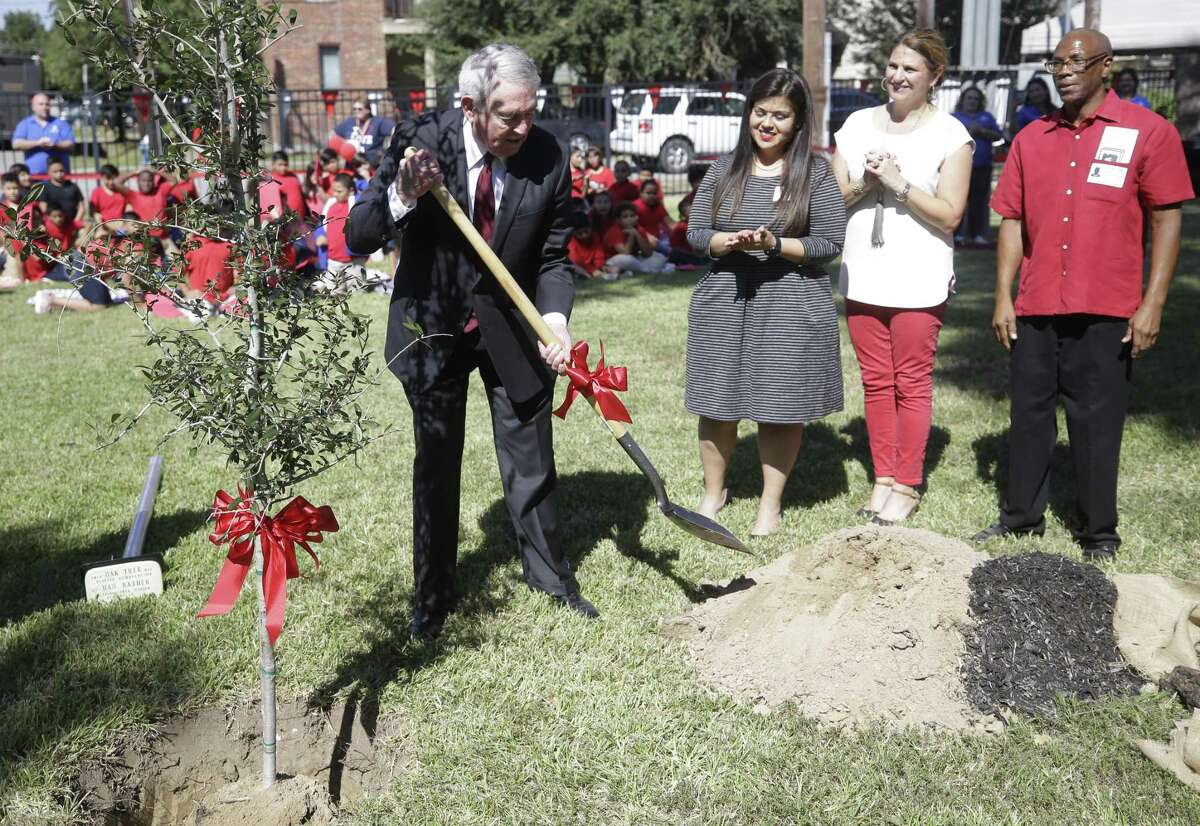 Dan Rather helps plant a tree at Love Elementary School during a program honoring him Friday, Oct. 12, 2018, in Houston. He was a student at the school in the late 1930s and recalls the trees in front of the school that were planted each year on Arbor Day while he was a student.