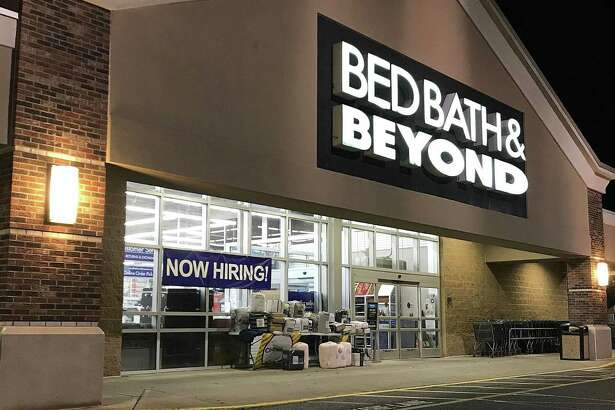 A 'Now Hiring' sign hangs in the window at Bed Bath & Beyond in Brookfield, Connecticut, on Tuesday, Oct. 16, 2018.