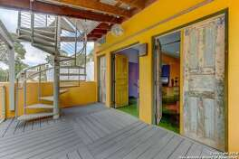 The former King William home of author Sandra Cisneros is once again on the market-with a completley new look.