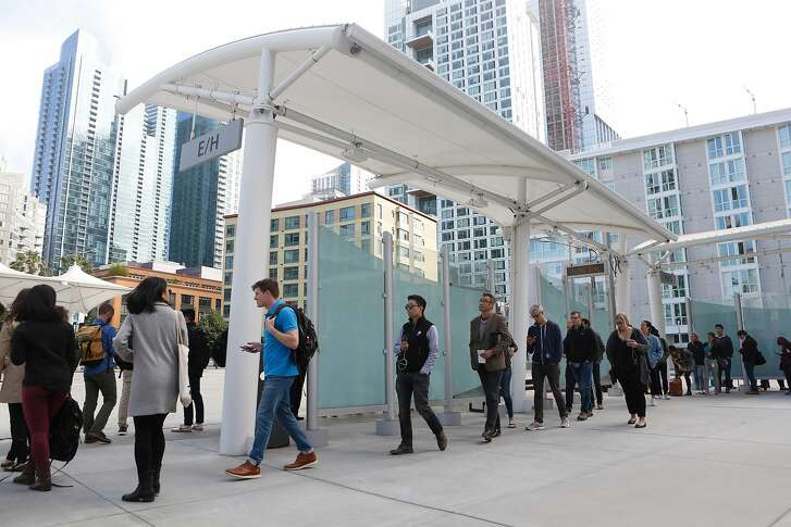 Pedestrians line up on the bus deck at the Transbay Center on Thursday, July 26, 2018 in San Francisco, Calif.