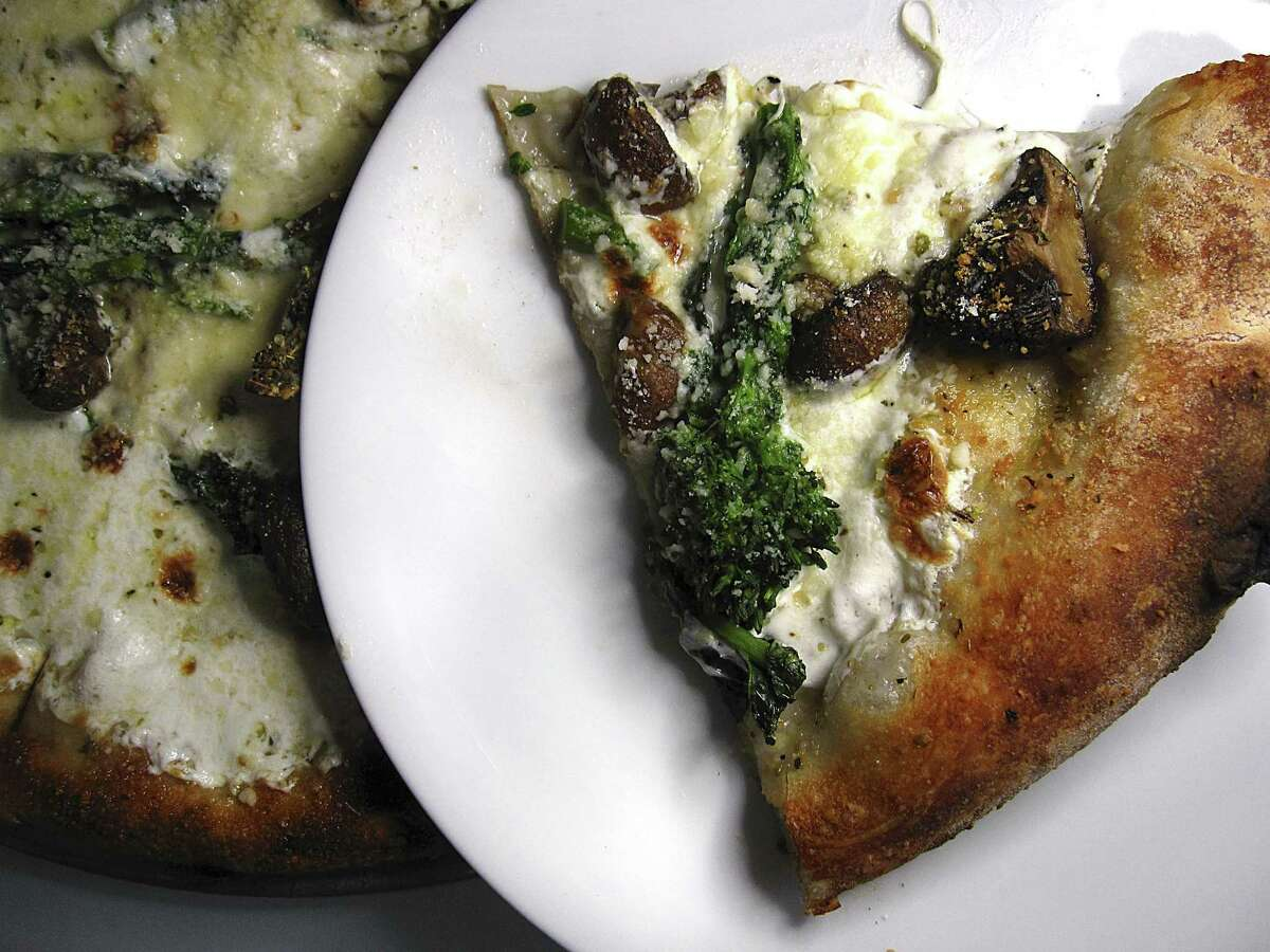 Safe Trip pizza with mushrooms, broccoli rabe, mozzarella and rosemary from Playland.