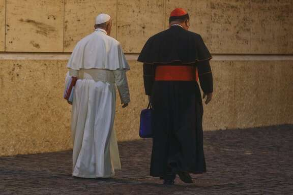 Pope Francis walks along Cardinal Gerald Cyprien Lacroix as he leaves after opening the 15th Ordinary General Assembly of the Synod of Bishops, at the Vatican, Wednesday, Oct. 3, 2018. Pope Francis urged Catholic bishops to dream of a future free of the mistakes of the past as he opened a global church leadership meeting Wednesday amid renewed outrage over the priestly sex abuse and cover-up scandal. (AP Photo/Gregorio Borgia)