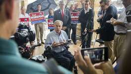 Gov. Greg Abbott and Rep. Paul Workman answers questions from the local News Media after they made their way to Randalls supermarket to cast their early voting ballot on Tuesday, Feb. 20, 2018. RICARDO B. BRAZZIELL / AMERICAN-STATESMAN