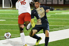 Father McGivney defender Luke Deakos, right, steps in the way of a Murphysboro player near midfield during the first half of Wednesday's Class 1A Belleville Althoff Sectional semifinal in Belleville.