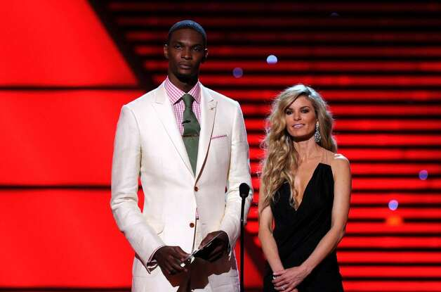 LOS ANGELES, CA - JULY 14:  NBA player Chris Bosh of the Miami Heat and model Marisa Miller speak onstage during the 2010 ESPY Awards at Nokia Theatre L.A. Live on July 14, 2010 in Los Angeles, California.  (Photo by Kevin Winter/Getty Images) *** Local Caption *** Chris Bosh;Marisa Miller Photo: Kevin Winter, Getty Images / 2010 Getty Images