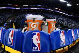 OAKLAND, CA - JANUARY 27: A detailed view of the Gatorade coolers sitting behind the Golden State Warriors bench prior to the start of an NBA basketball game between the Warriors and Boston Celtics at ORACLE Arena on January 27, 2018 in Oakland, California. NOTE TO USER: User expressly acknowledges and agrees that, by downloading and or using this photograph, User is consenting to the terms and conditions of the Getty Images License Agreement. (Photo by Thearon W. Henderson/Getty Images)