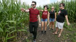 Tom Troy, from left, Denise Stepp, Melissa Irish and Ryan Irish decide where to go as they navigate the trails in the Traders Village Corny Maze. To be successful, a maze has to be near a large population center. And as the only corn maze located within the San Antonio city limits, the Corny Maze is in a sweet spot.